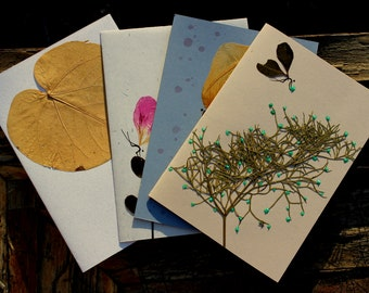 4 Holiday hand- made greeting cards. One of a kind, made from quality recycled paper.
