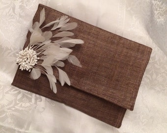 Coffee clutch bag with ivory feathers and a cluster of beads