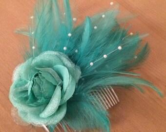Jade green feather fascinator, bridesmaid hairpiece. decorative comb