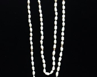 Cultured seed pearls and 14 K gold balls.