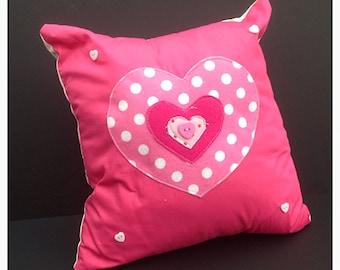 Pink cushion in heart shape