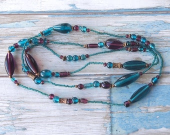 Lovely long vintage seed bead necklace with sea blue, purple and bronze tone beads