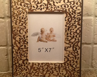 Picture frame with pyrography design