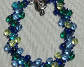 Blue/green cross needle weave bracelet