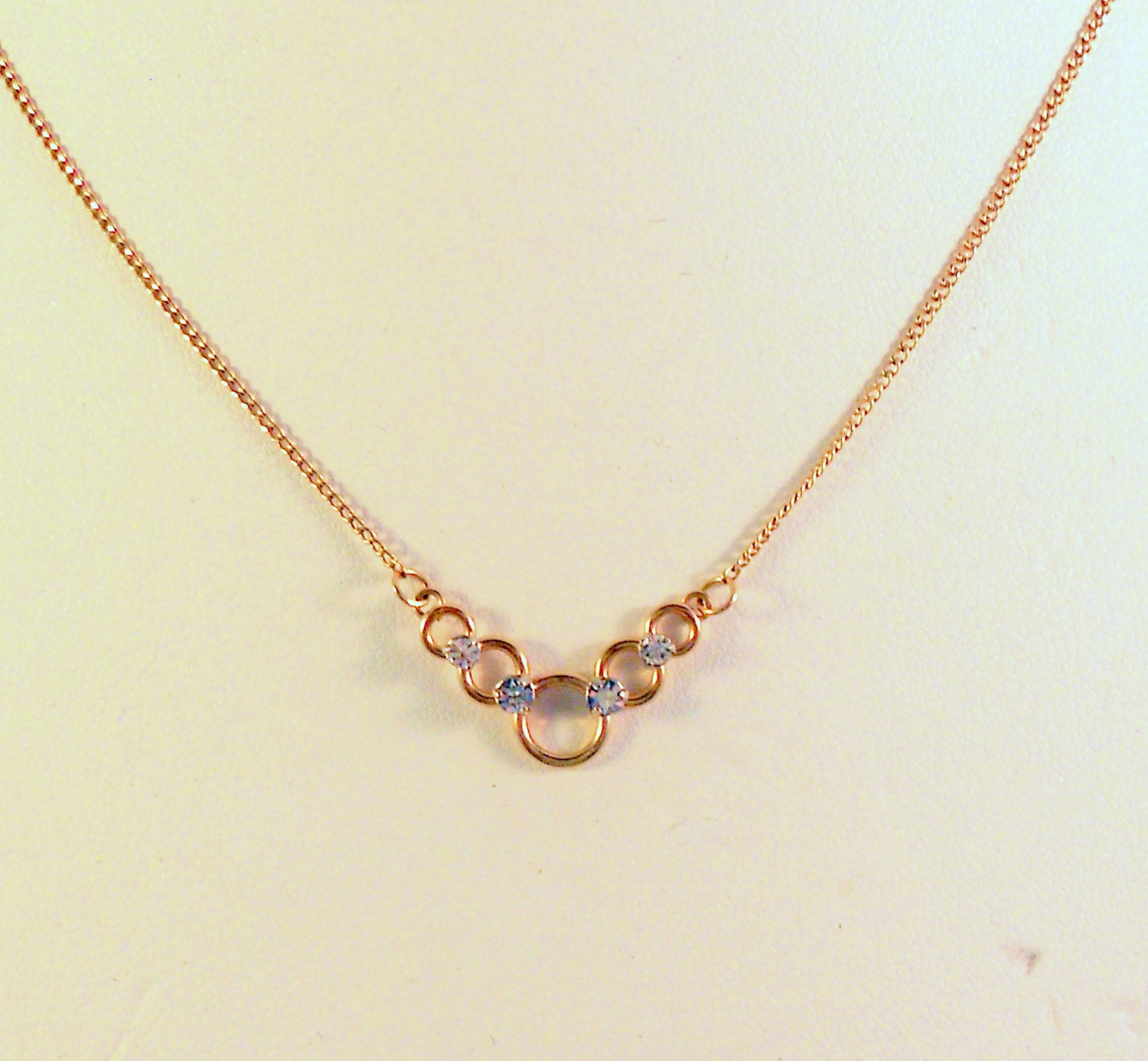 krementz vintage gold tone necklace with graduated rings and