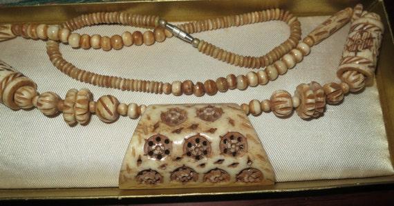 Vintage 1950s handcrafted carved bone longline necklace
