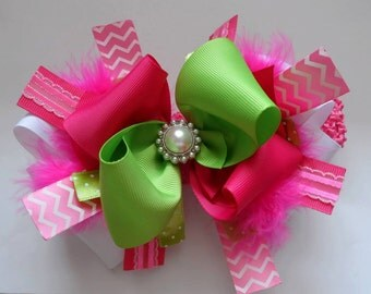 Hot pink and lime green hair bow.