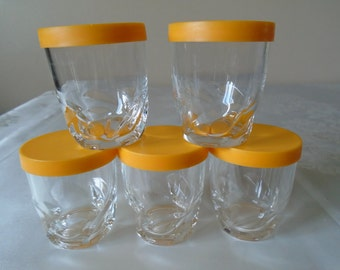small glasses with plastic seals /covers