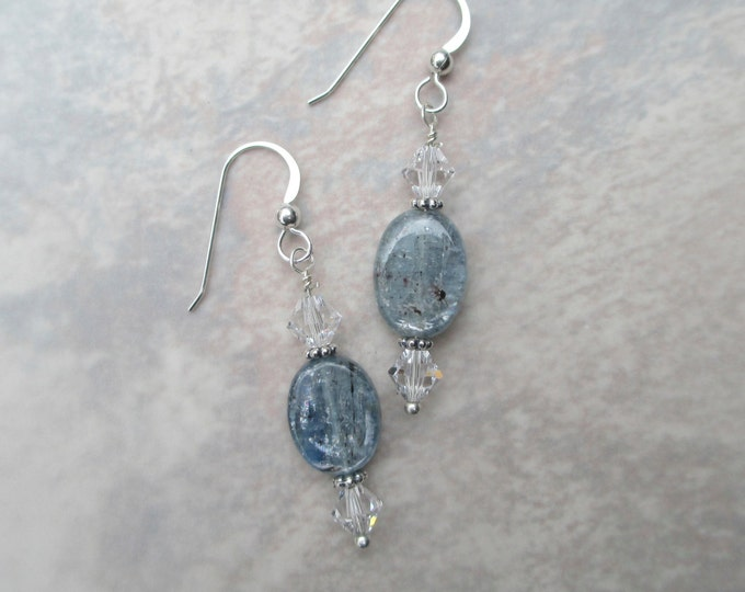 handmade blue grey kyanite earrings with clear Swarovski crystals and sterling silver spacer beads on a sterling silver ear wire