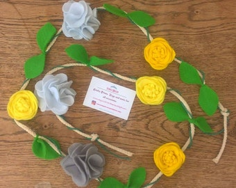 Yellow and grey flower garland bunting for home decor or photo shoots.