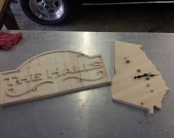 Wooden signs and wall clocks