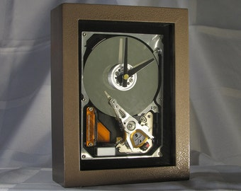 Engineer or Teacher gift for anyone who works on computers. Techie/Display/Desktop/Mantel/Steampunk clock made from a computer hard drive