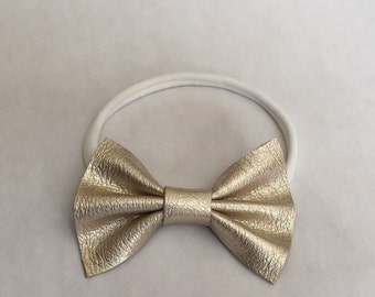 Platinum gold leather bow