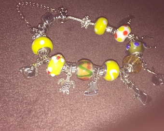 """Yellow and silver charm bracelet 8"""""""