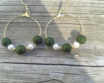 Green and gold Hoop Earrings with Green Rubberized Beads, Glass Pearl Beads, and Gold Plated Beads.