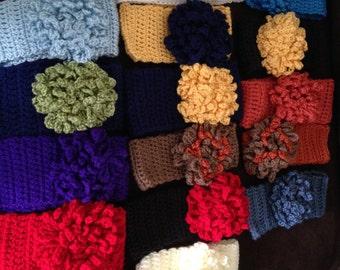 Handmade Crochet Ear Warmers with a flower
