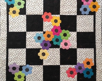 Black and White quilt or wall hanging with colorful hexi flowers