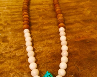 Authentic turquoise fossilized stone  and wood necklace