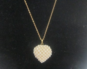 Necklace in gold 18 k, or massif, and freshwater pearls, 18 k gold
