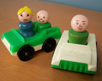 Two Vintage Fisher Price Little People vehicles and 3 wooden figures – green and white cars, male, female, boy