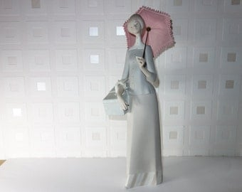 "Lladro ""Dressmaker with umbrella"" No 4700 I've broken the umbrella so GBP125 off"