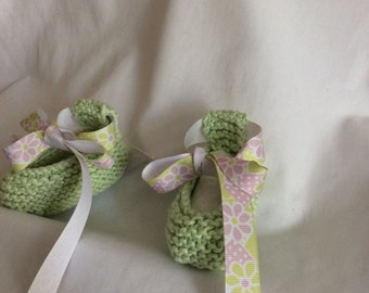 Baby booties in pale green.
