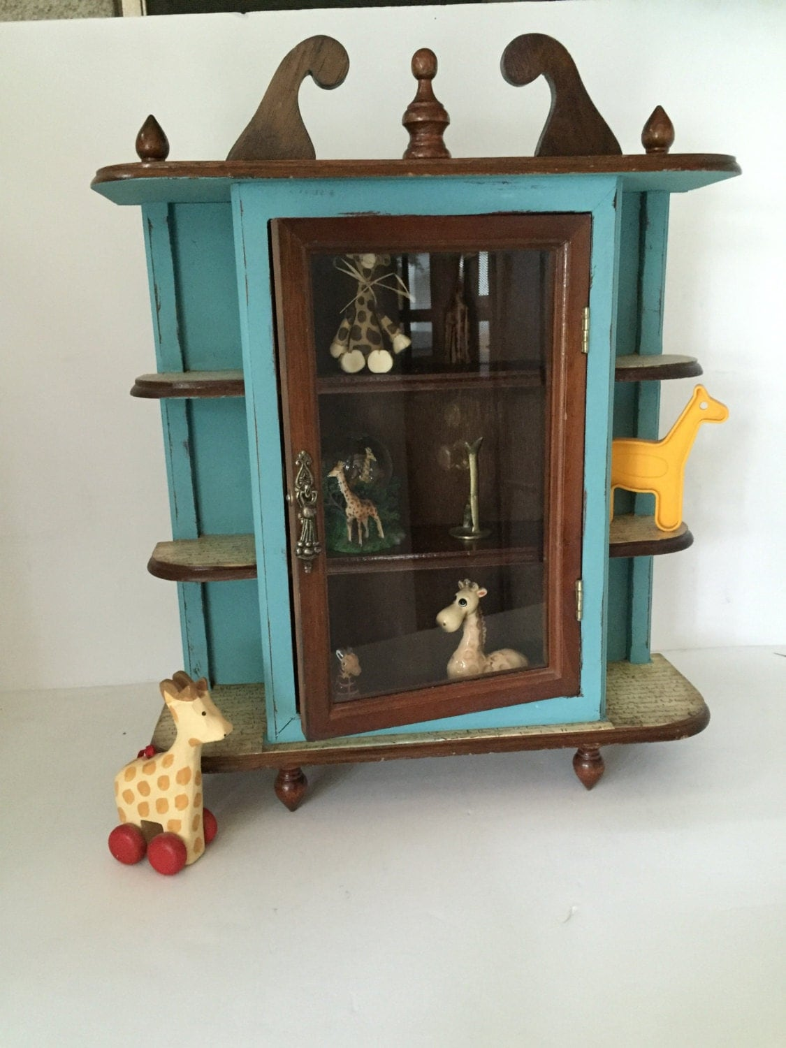 teal collectible cabinet display turquoise display shelf teal. Black Bedroom Furniture Sets. Home Design Ideas