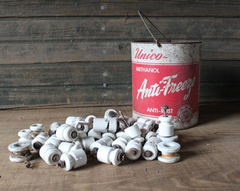 Bucket of old electric fence insulators