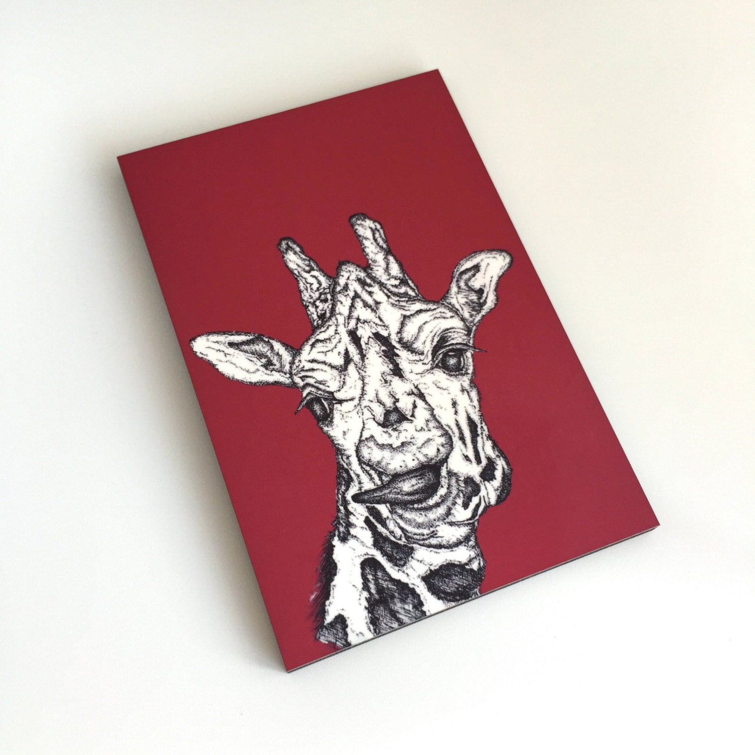 Red giraffe art print on mdf board by