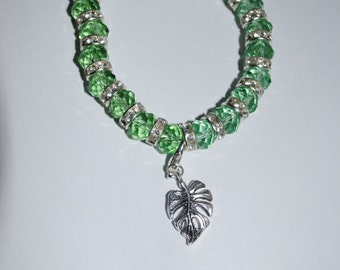 green sparkle bracelet with silver plated leaf charm