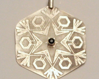 Silver pendant snowflake with sapphire