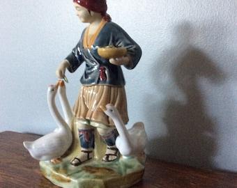 Mud Man Figurine - Man with Ducks