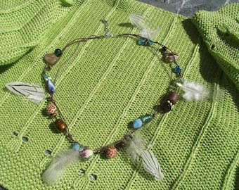 Necklace feathers in madness