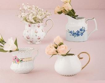 Assortment of porcelain milk pots