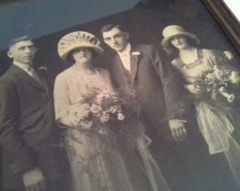 Instant relatives!....vintage photo in glass frame