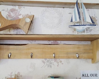 Handmade shelf with coat hooks