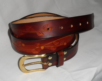 embossed full grain leather belt with a brass buckle