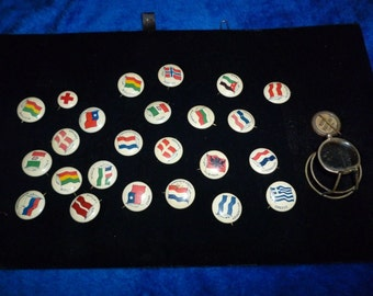Pins of flags of the world dating back to the C. 40's