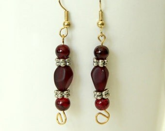 Red, silver and gold toned, dangle earrings