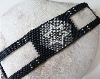 Cuff bracelet weaved black with star, rock, ethnic, smart