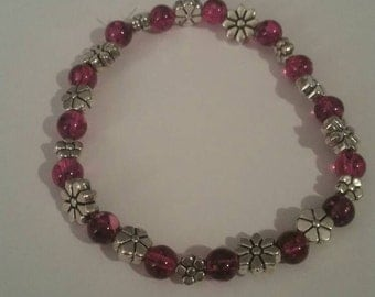 Pink spotted glass beads with silver flower beads.