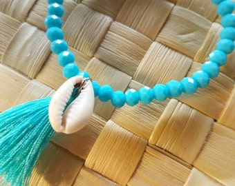 Crystal blue cowrie shell bracelet- crystal beaded with a cowrie shell and a turquoise colour tassel blue bracelet- tassel jewelry.