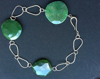 Handmade sterling silver statement necklace featuring three green agate stones.
