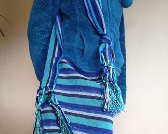 Adjustable strap crossover bag with tassels