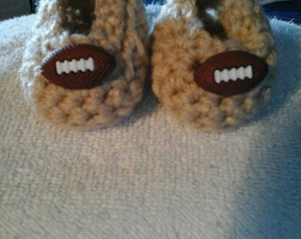 Adorable little football Booties size 0-3 months