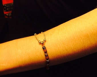 Bracelet from recycled guitar string