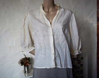 German made loose fitting white women's blouse (size M-L)