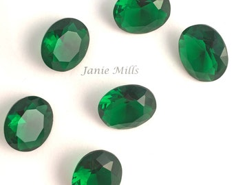Emerald faceted gemstone 10x12mm oval