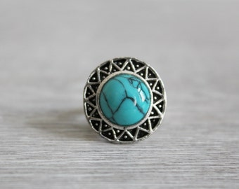 Silver ring with turquoise in the ethnic style