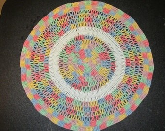 hand crocheted round pastels doily